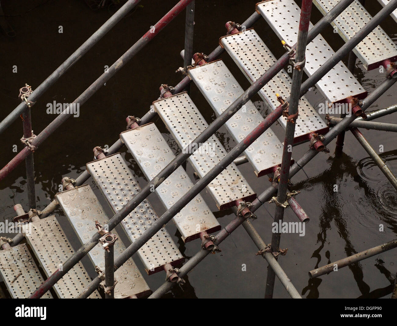 Metal Stairs On Scaffolding Over River   Stock Image