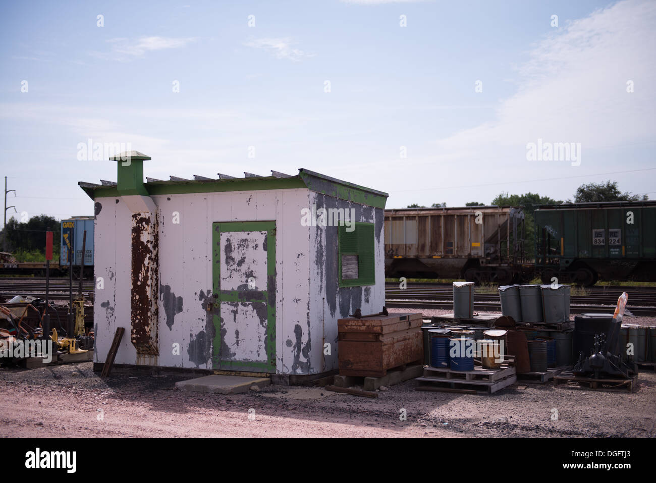 Rusty utility structure - shed - by a railroad - Stock Image