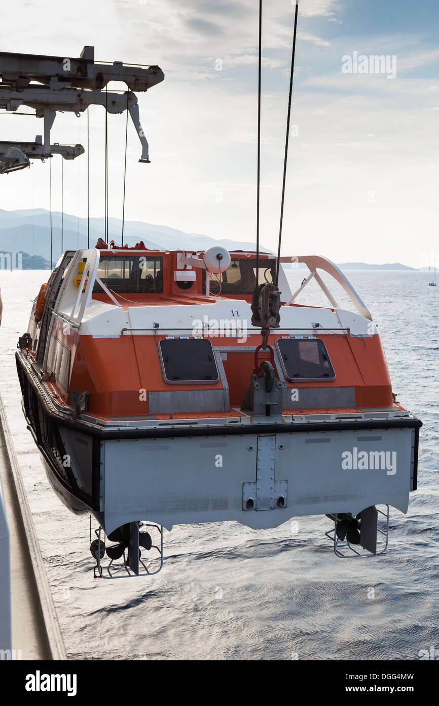 Raising lifeboat from sea back to ship Korcula Cunard Liner Queen Victoria Stock Photo