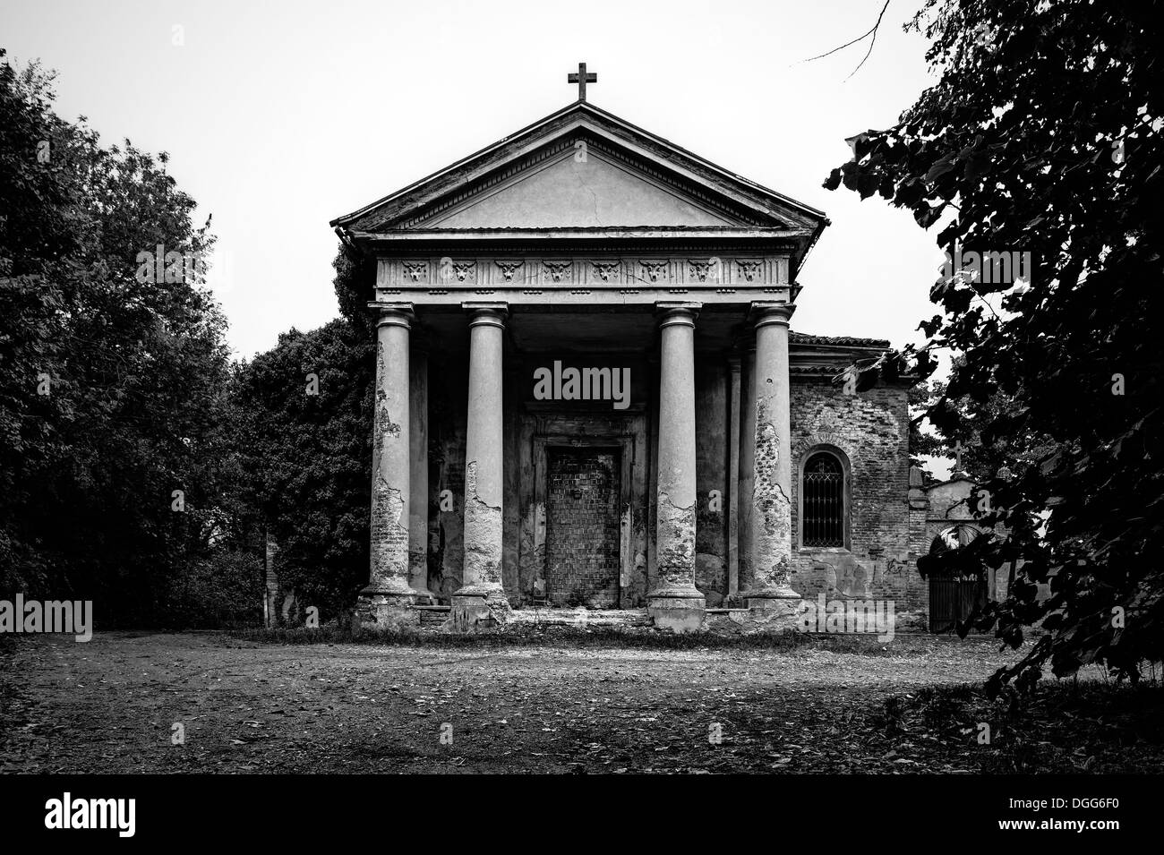 Italy. Abandoned church with walled-up door - Stock Image
