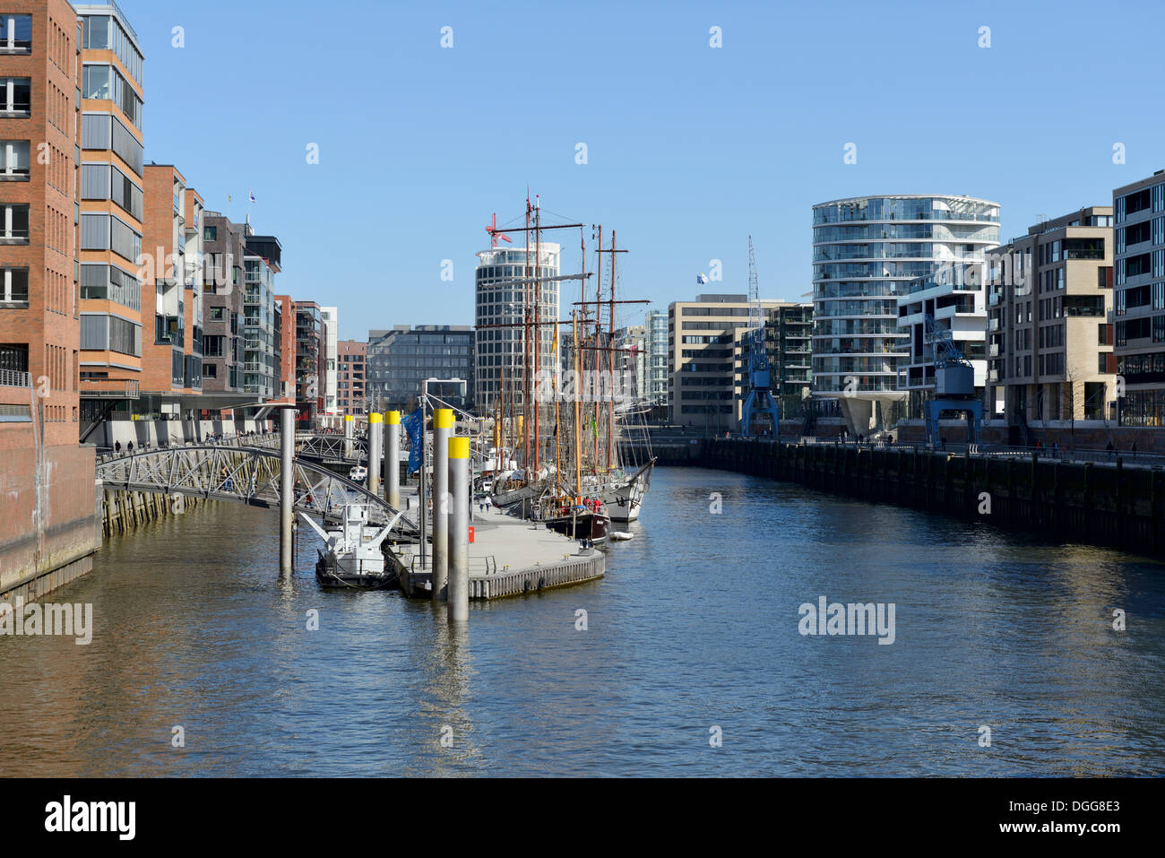 Historic sailing vessels in the Traditionsschiffhafen harbor, modern residential and office buildings, Sandtorhafen - Stock Image
