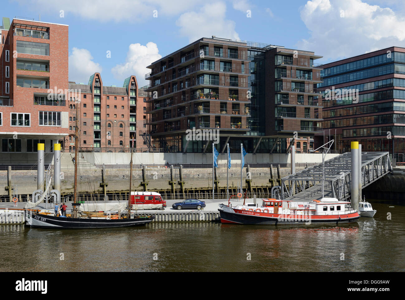 Ships moored at Tall Ship Harbour, Traditionsschiffhafen harbour, historic harbour with modern residential and office buildings - Stock Image