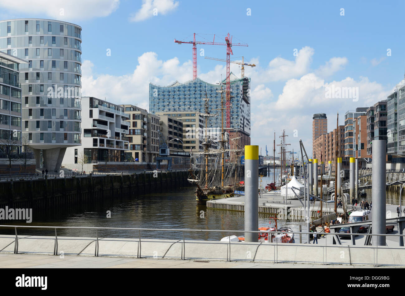 Ships are moored in the Tall Ship Harbour, Traditionsschiffhafen harbour, modern residential and office buildings, Stock Photo