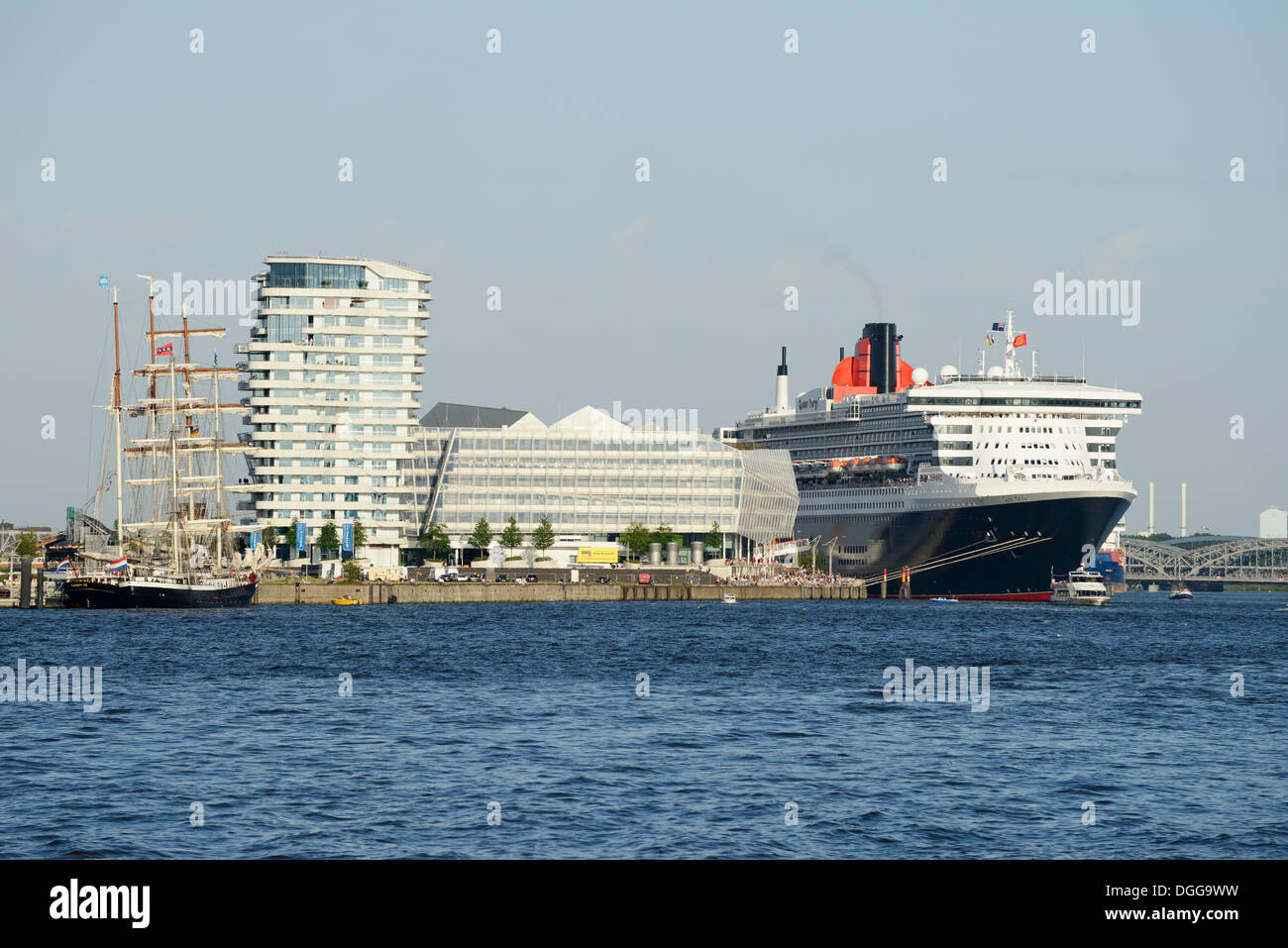 RMS Queen Mary 2 visiting during Hamburg Cruise Days in the Port of Hamburg, with the Marco Polo Tower and the Unilever Stock Photo