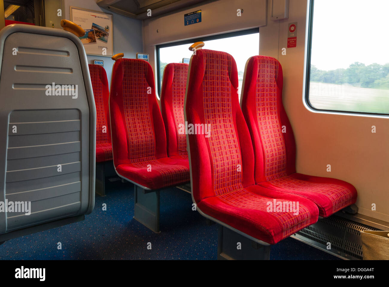 empty seats in railway carriage - Stock Image