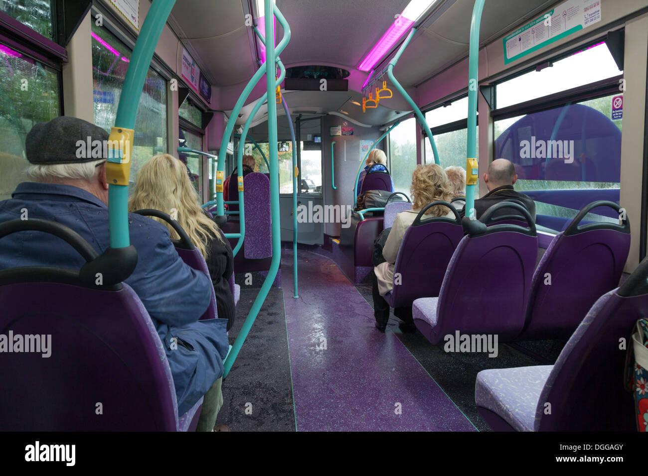 Passengers on single decker public bus. - Stock Image
