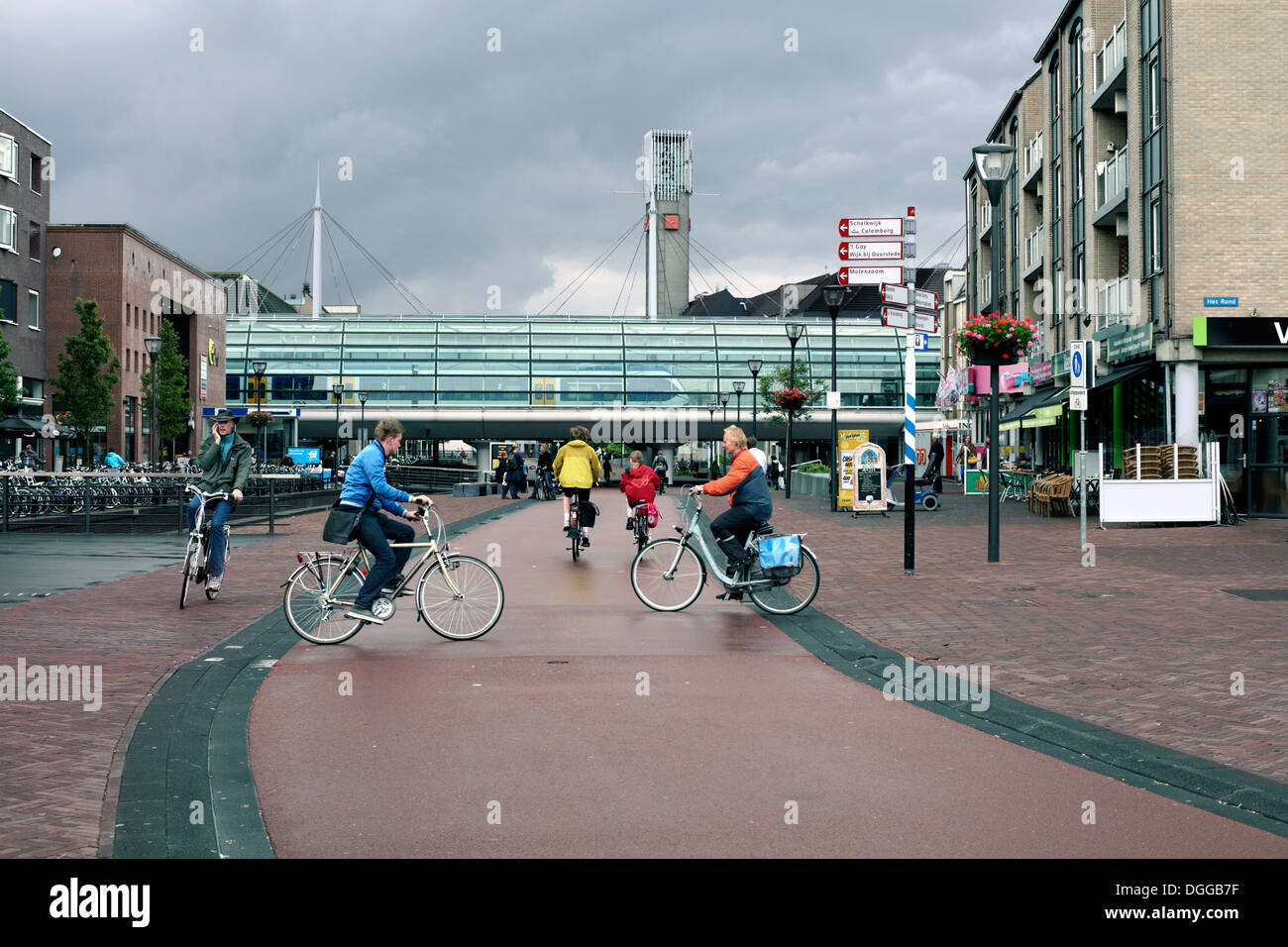 Cyclists in Houten's traffic-free town centre, a Dutch new town near Utrecht, The Netherlands. - Stock Image