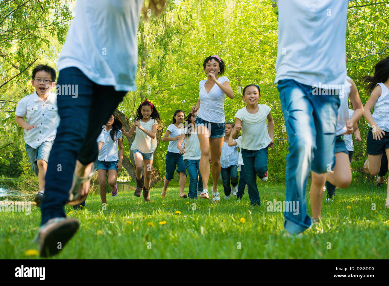 People running in park - Stock Image