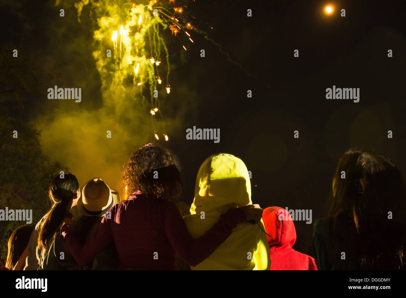 Group of people watching firework display - Stock Image