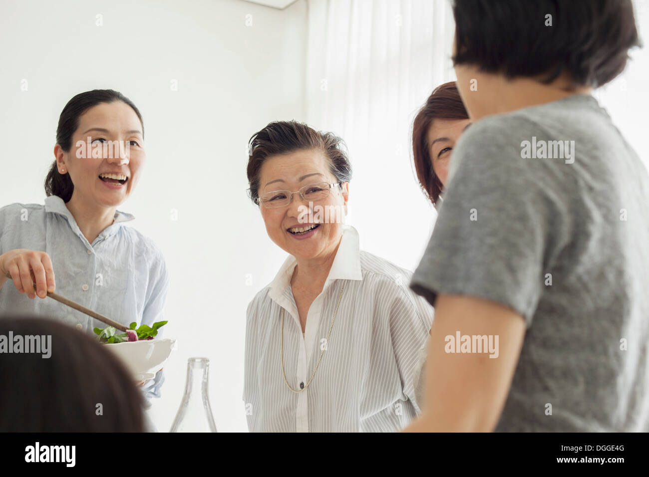 Senior woman with adult daughters - Stock Image