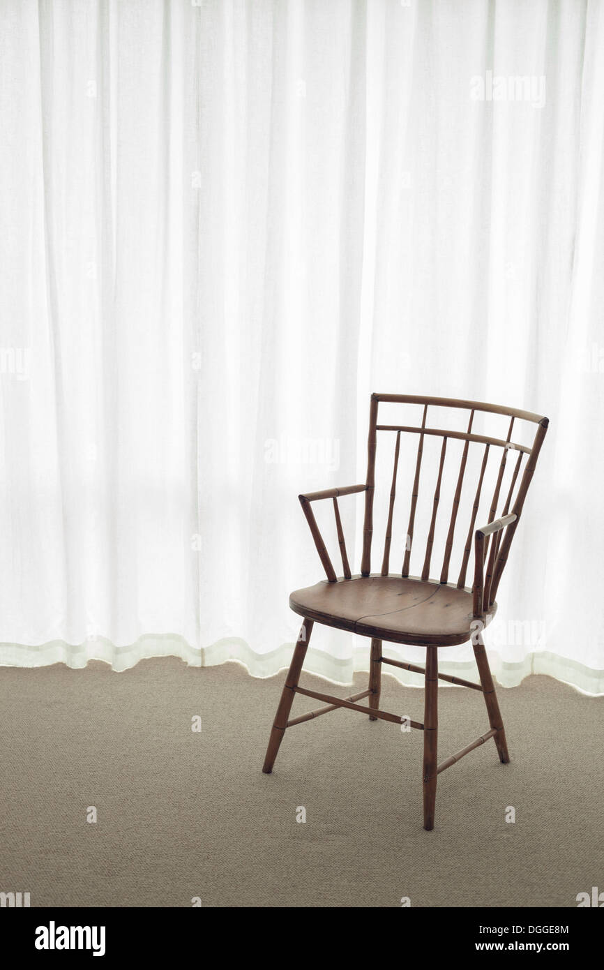 Empty wooden chair - Stock Image