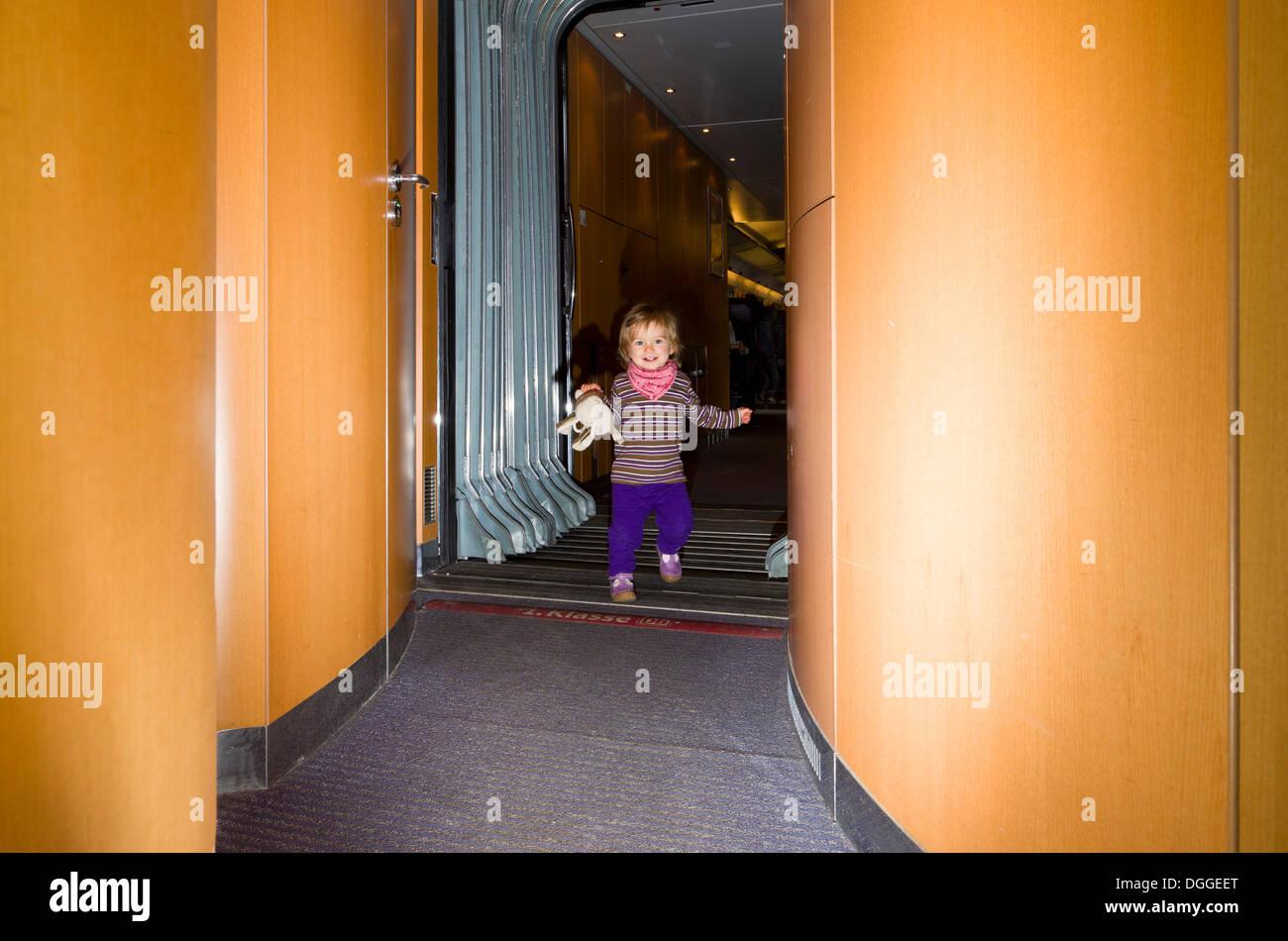 Small child walking inside ICE train, Dresden, Saxony, Germany - Stock Image