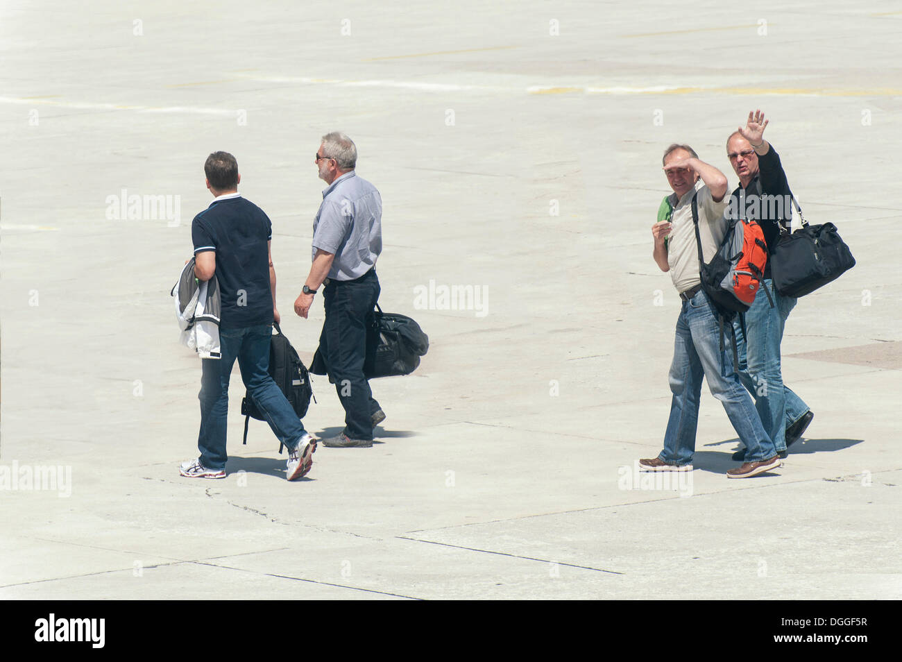 Four people walking across the tarmac to their plane, Split, Croatia, Europe - Stock Image