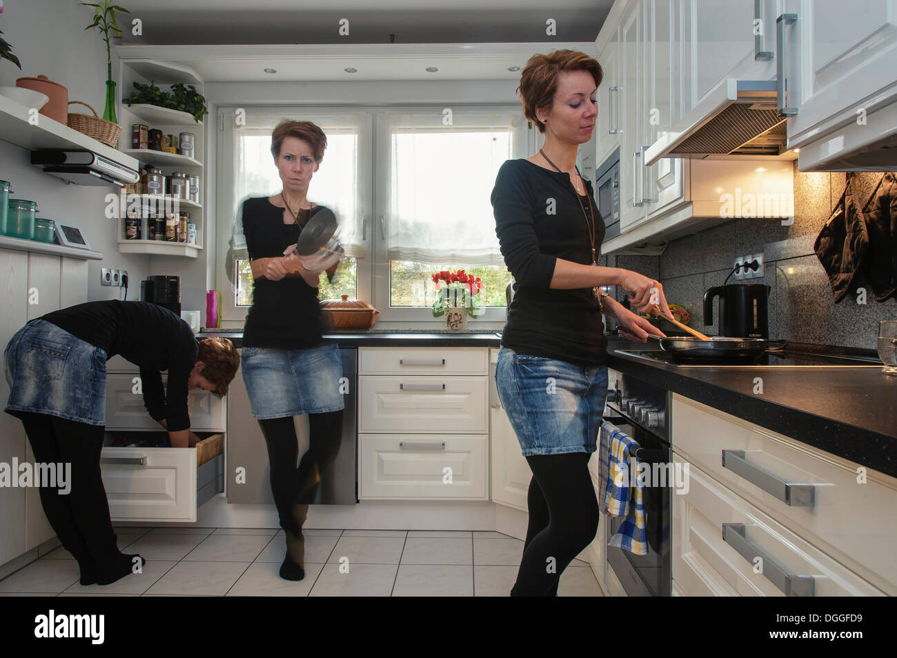 Young woman, depicted three times in the kitchen, Grevenbroich, North Rhine-Westphalia - Stock Image