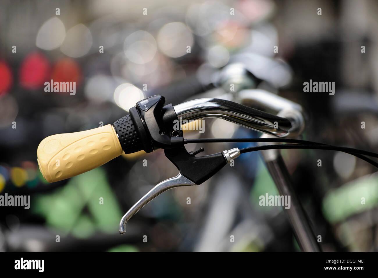 Bicycle handlebars with yellow handles, Neuss, North Rhine-Westphalia, Germany - Stock Image