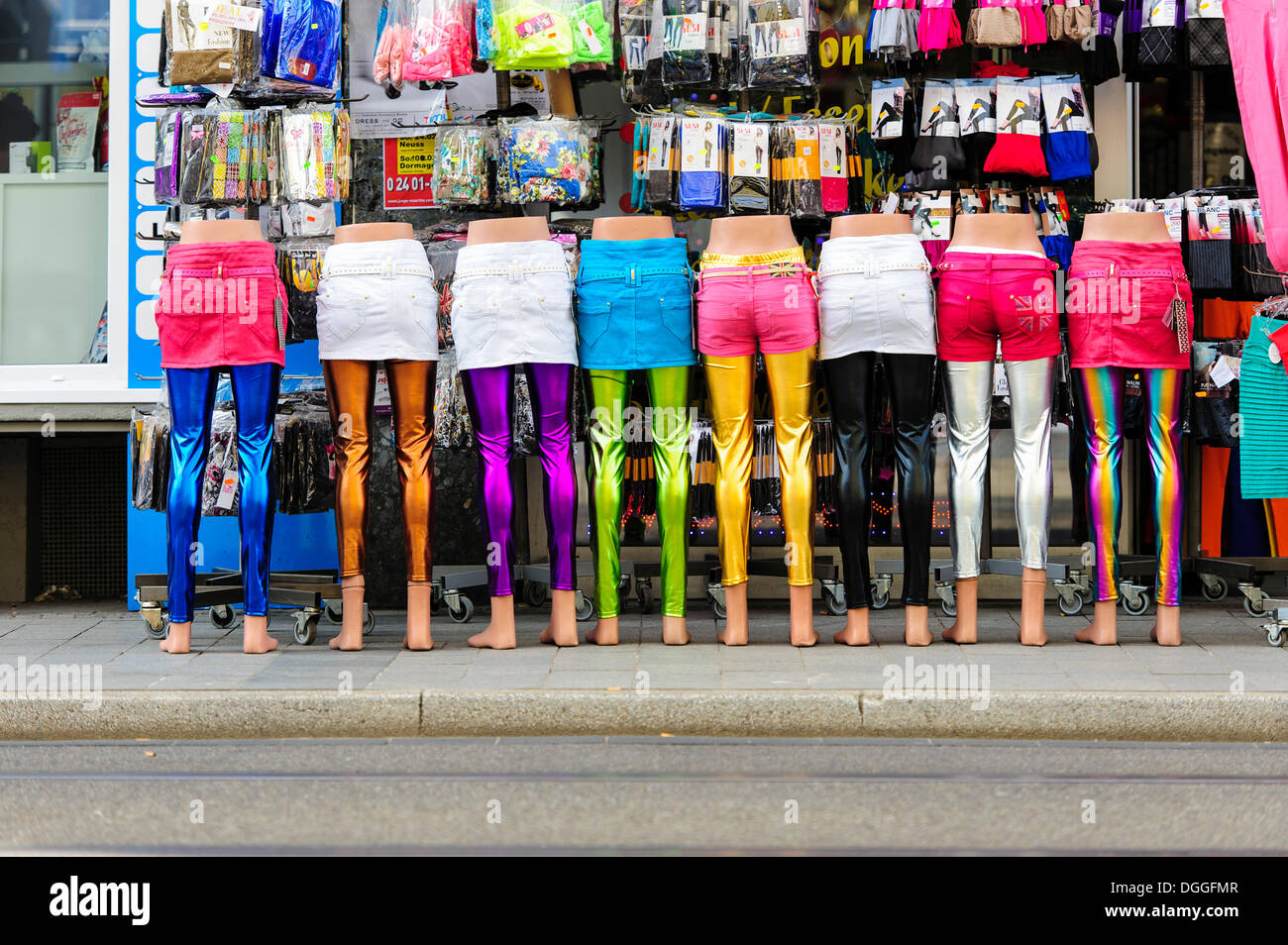 Legs of mannequins standing in a row in front of a clothing store, Neuss, North Rhine-Westphalia, Germany - Stock Image