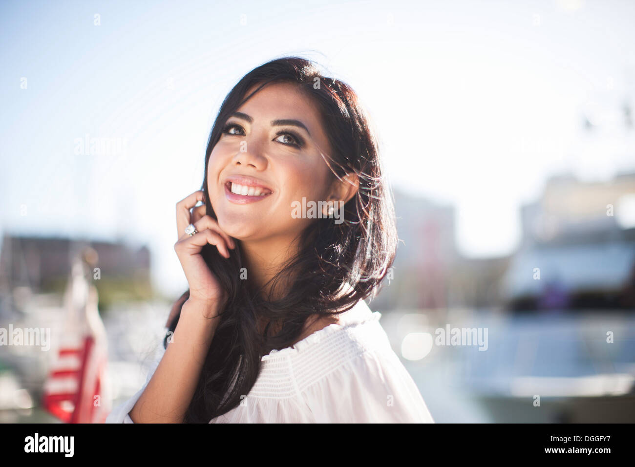 Portrait of young woman on yacht in marina, San Francisco, California, USA - Stock Image