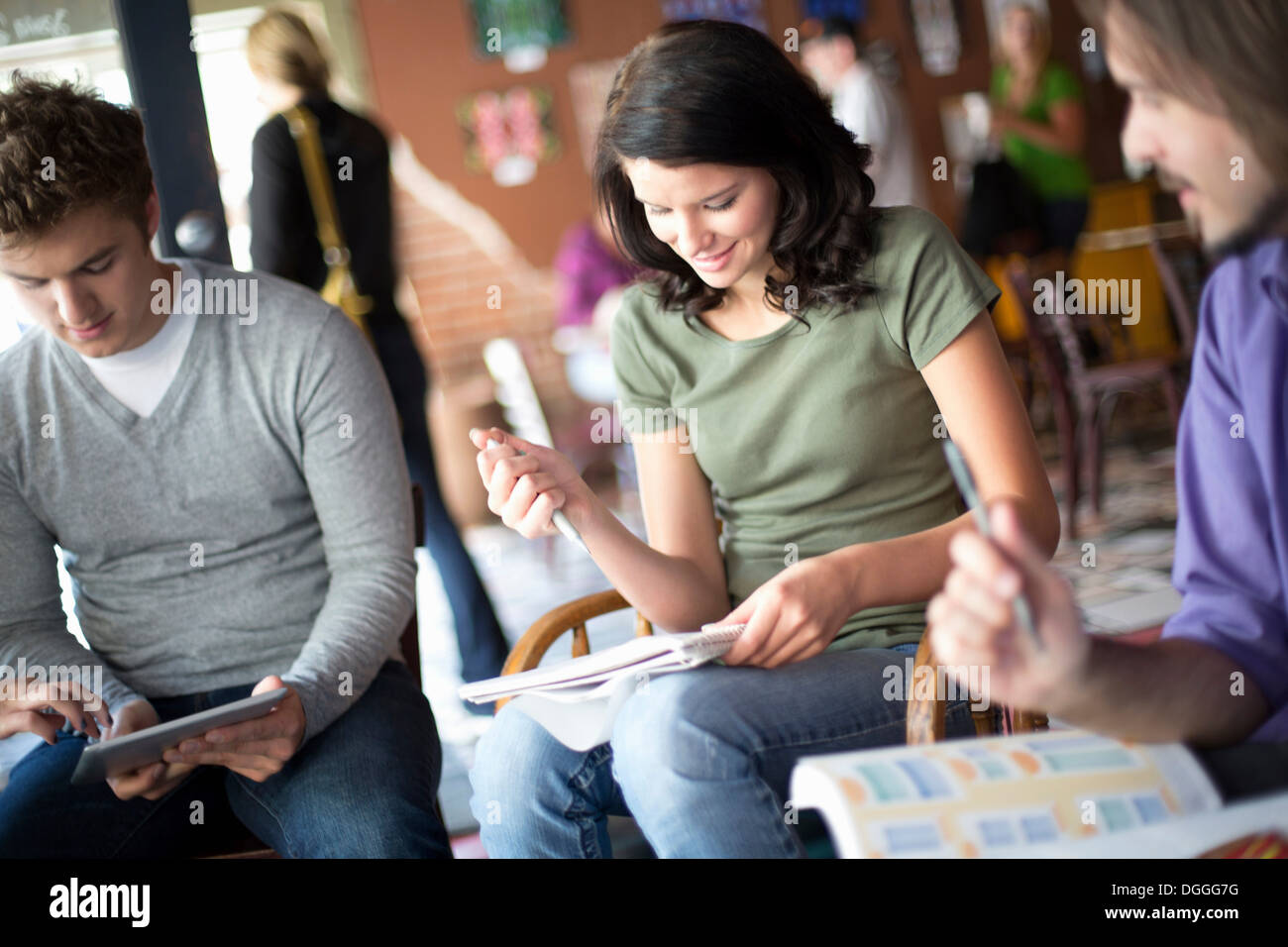 Small group of people studying in cafe - Stock Image