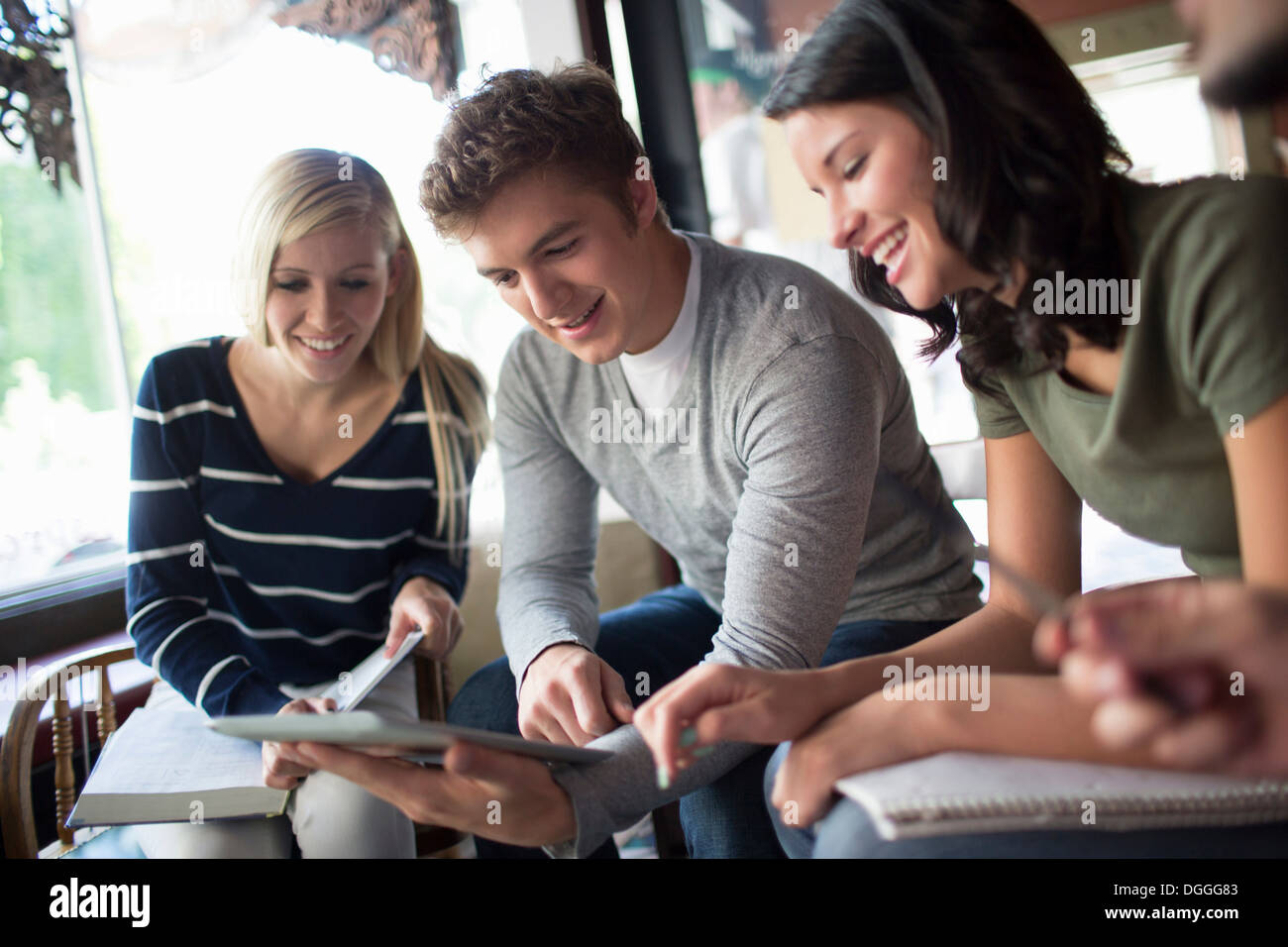 Group of people studying together in cafe - Stock Image