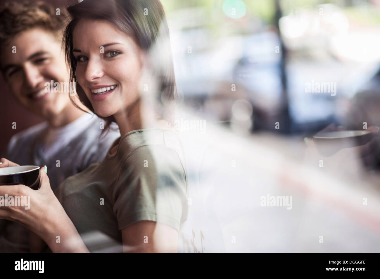 Young couple inside cafe - Stock Image
