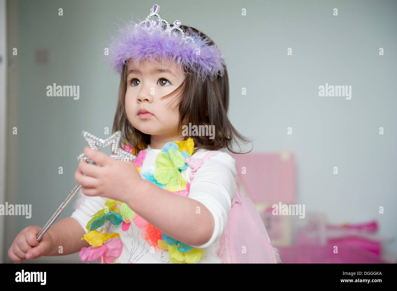 Girl in fairy costume holding magic wand - Stock Image