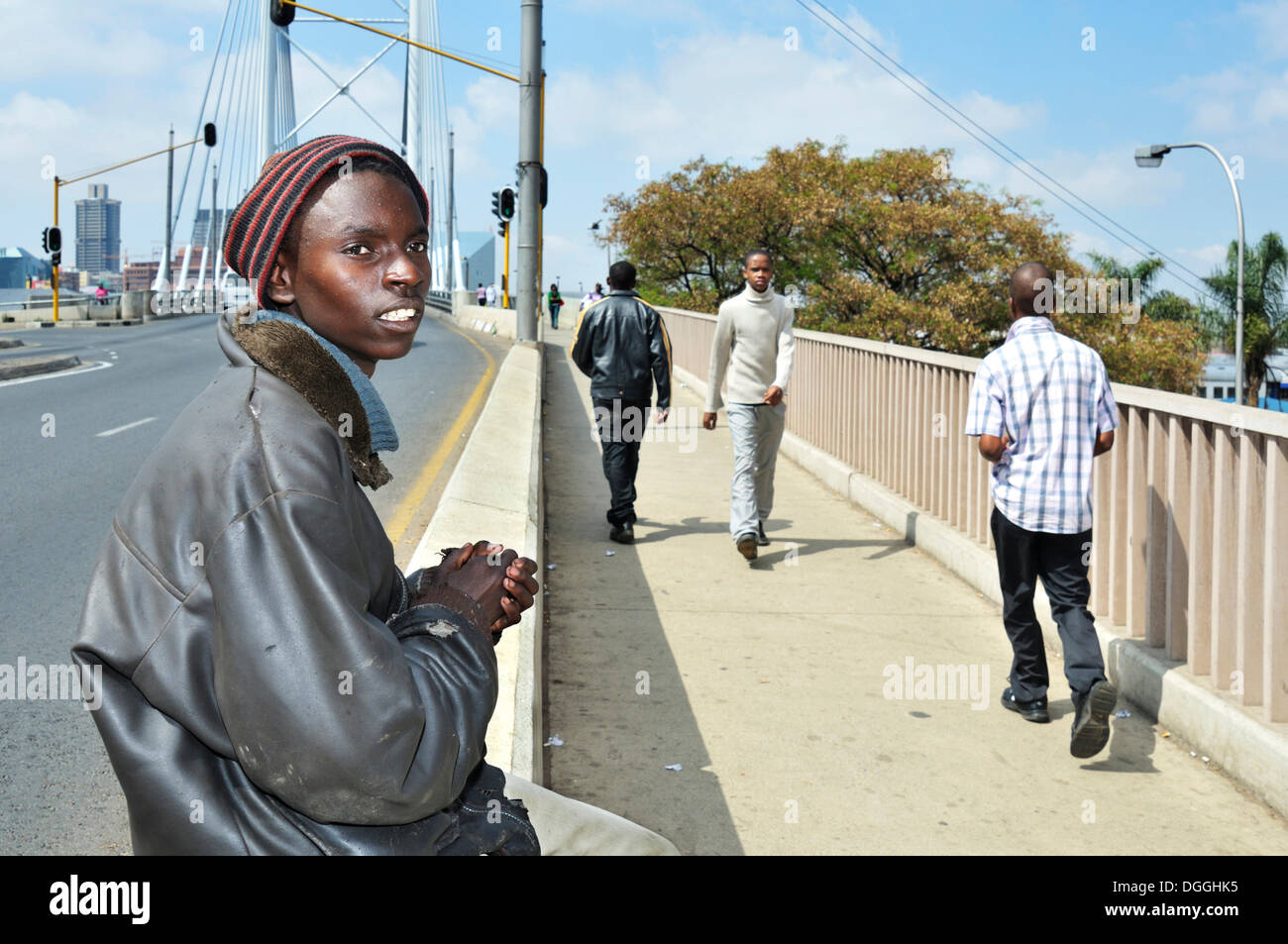 Street child begging on the Mandela Bridge, Johannesburg, South Africa, Africa - Stock Image