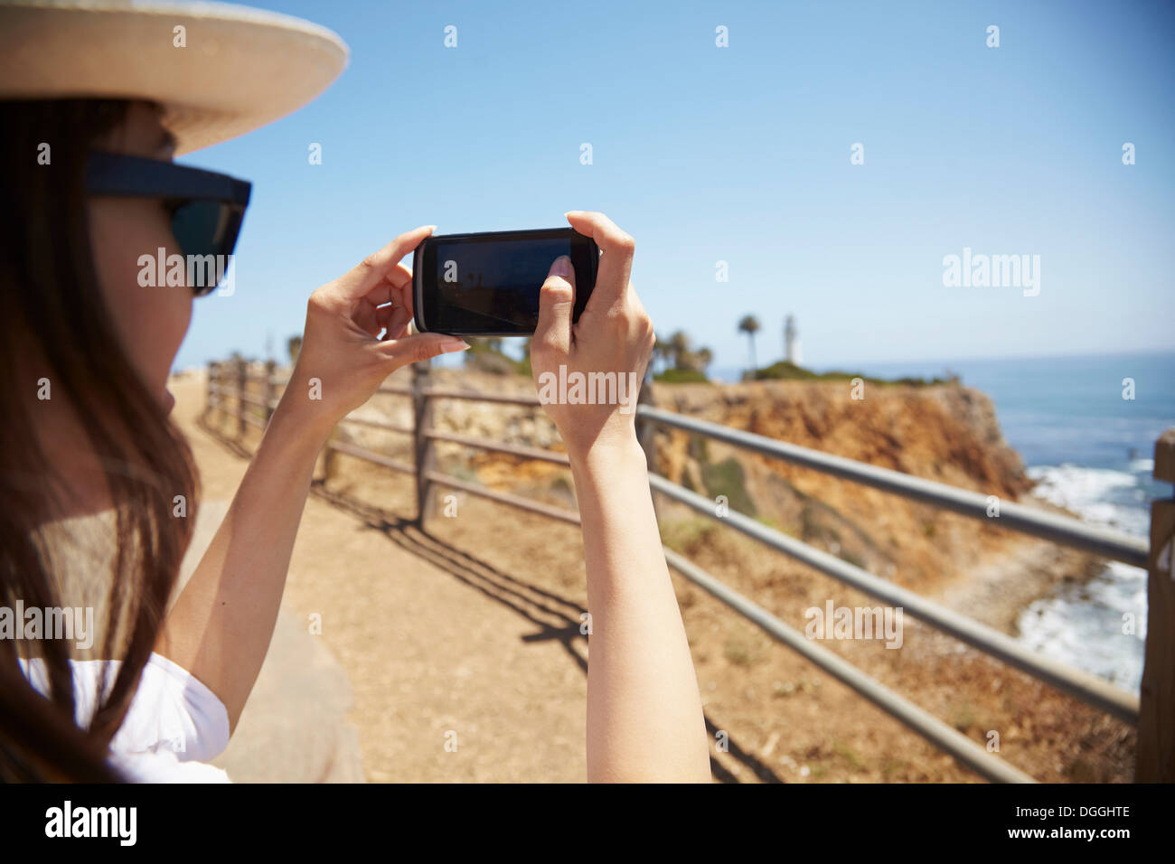 Young woman photographing view, Palos Verdes, California, USA - Stock Image