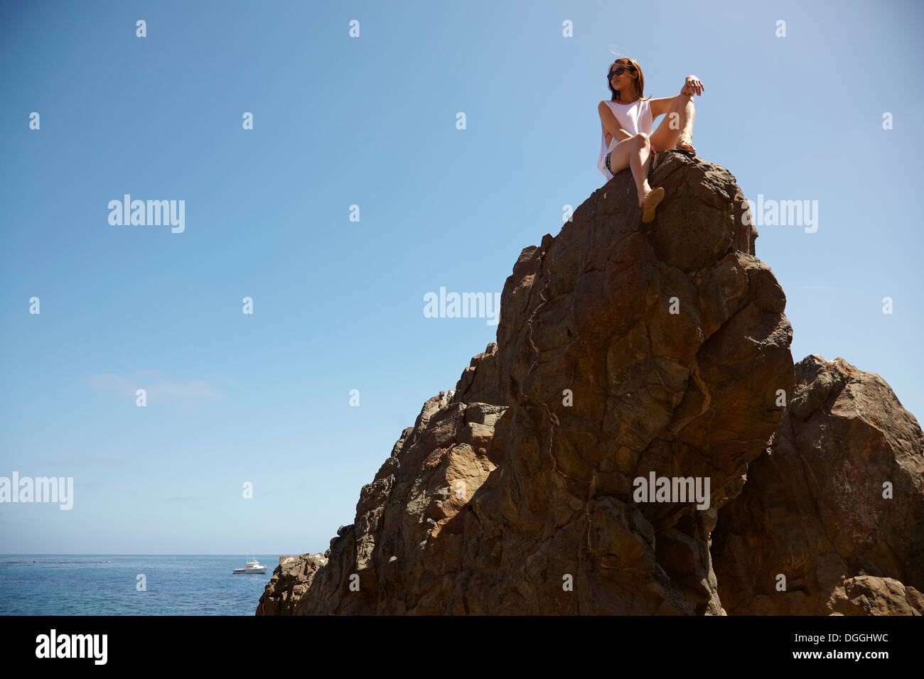 Young woman on top of rocks, Palos Verdes, California, USA - Stock Image