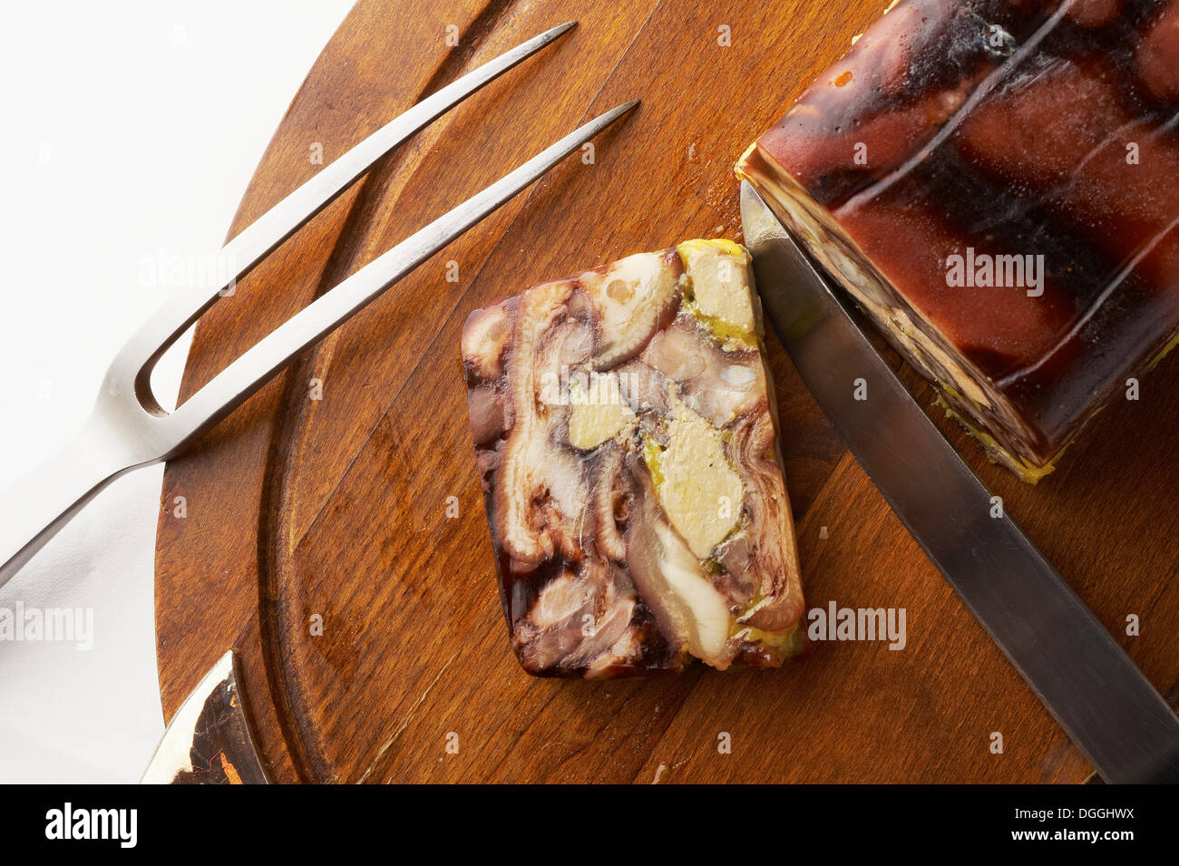 Still life with chopping board and sliced savory roulade - Stock Image