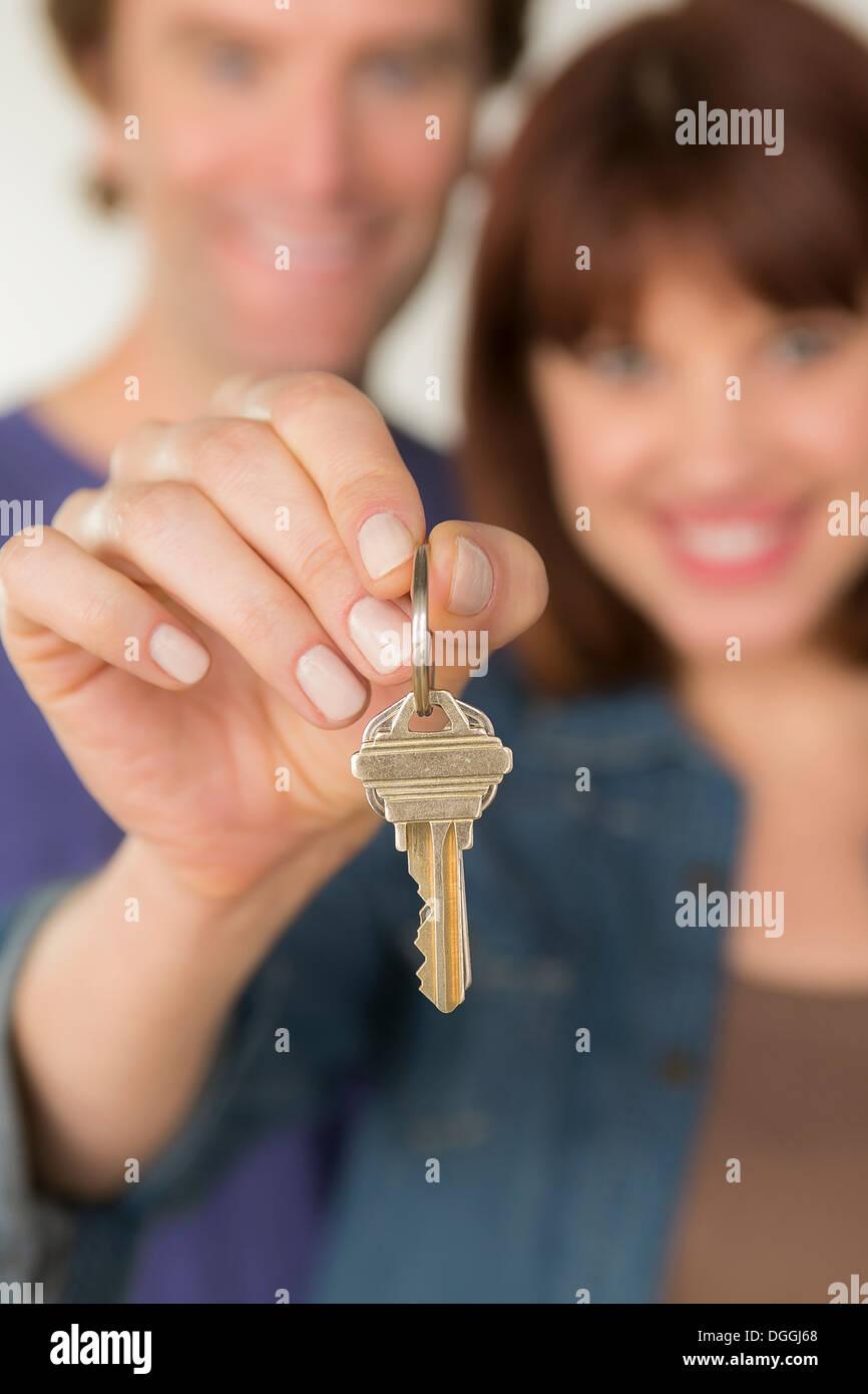 Couple holding new door key - Stock Image