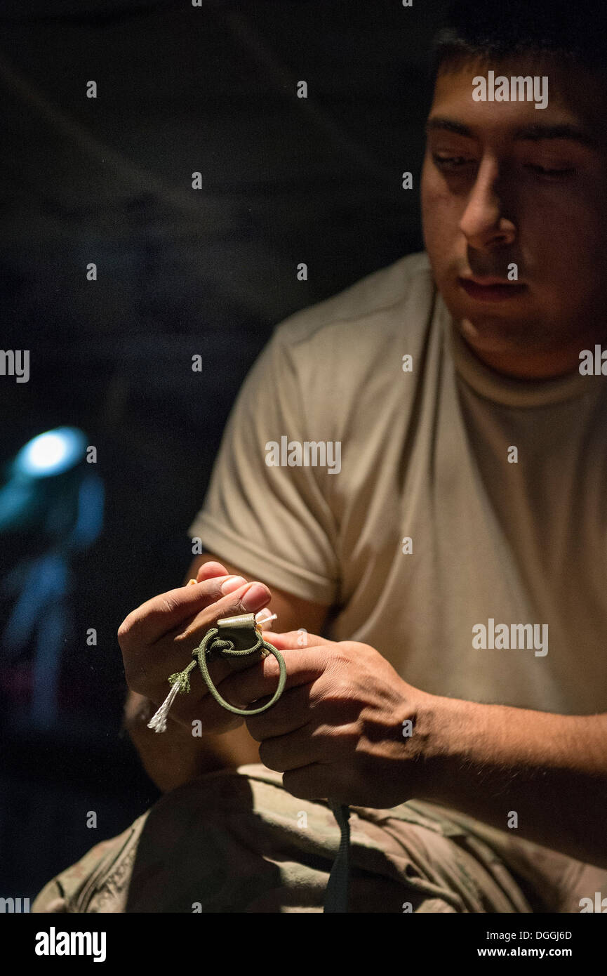 Spc. Philip Martinez, Combined Joint Special Operations Task Force-Afghanistan parachute rigger, prepares a cargo bundle for an - Stock Image