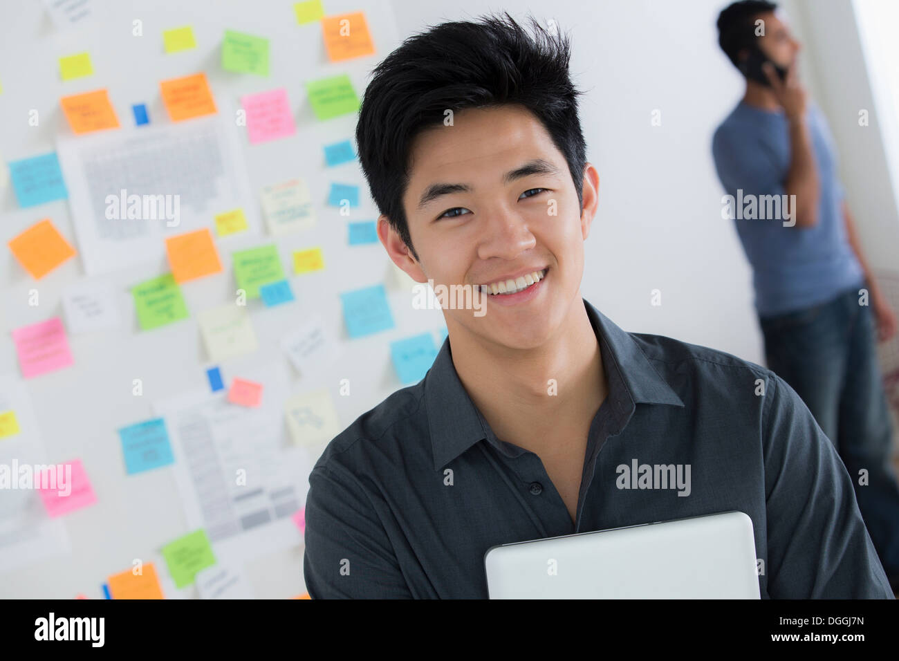 Male office worker holding digital tablet - Stock Image