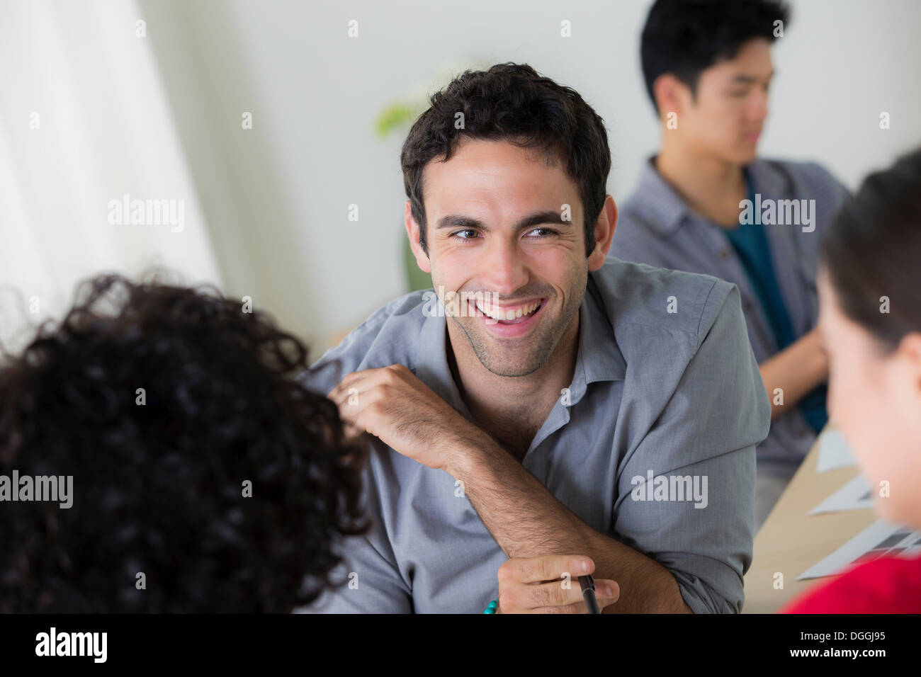 Office workers chatting - Stock Image
