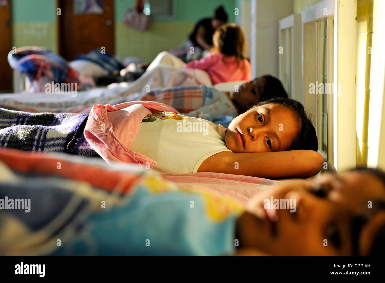 Girls going to sleep in the dormitory of an orphanage, Queretaro, Mexico, North America, Latin America - Stock Image