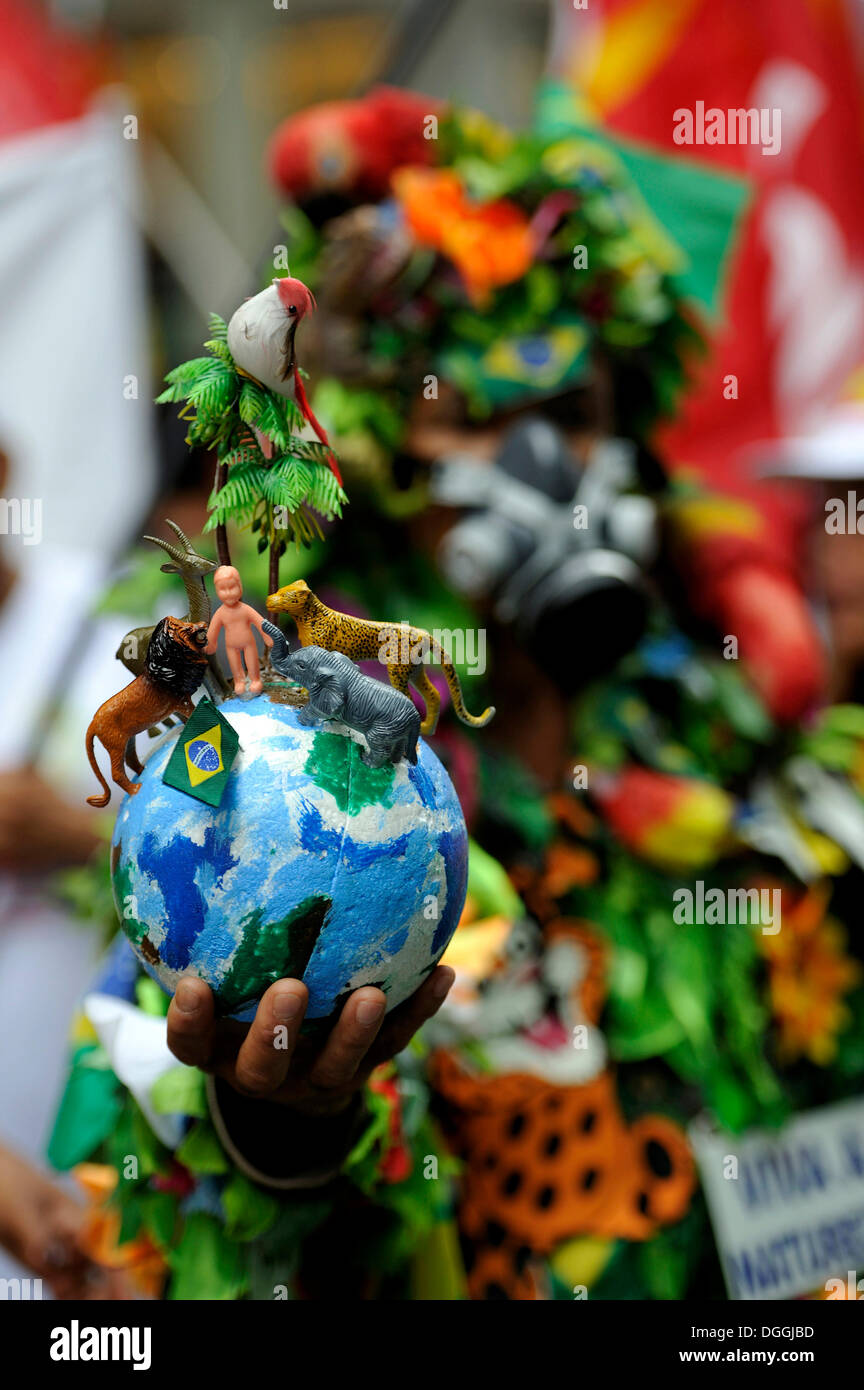 Demonstrator with globe with animals and plants, symbol of creation, UN Conference on Sustainable Development UNCSD or Rio +20 - Stock Image