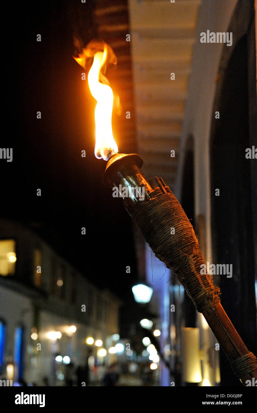 Torch illuminating a street in the old town of Paraty or Parati, Costa Verde, State of Rio de Janeiro, Brazil, South America - Stock Image