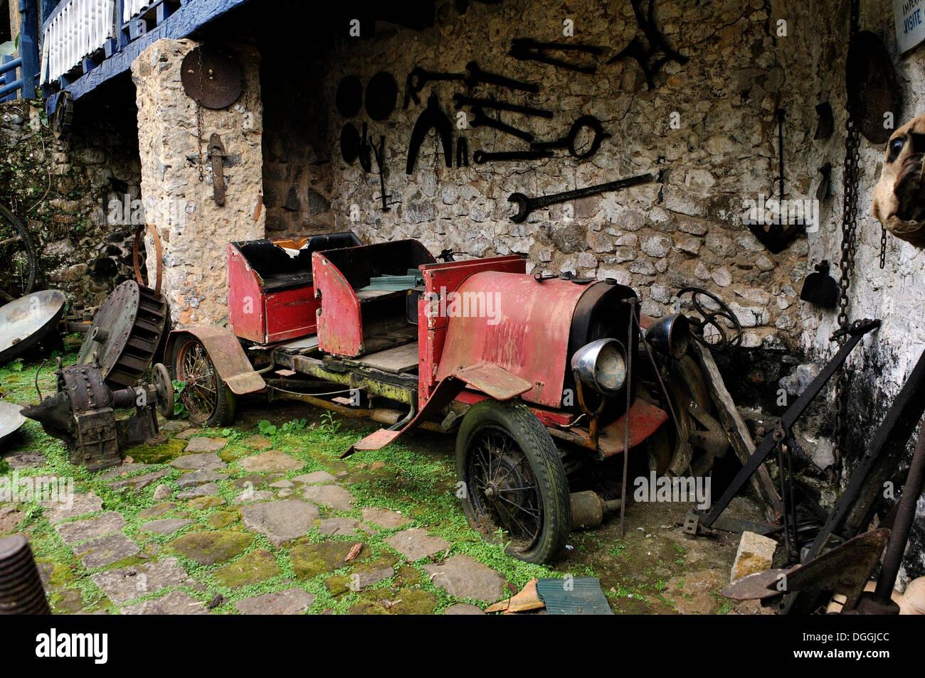 Scrap car, vintage car on the dilapidated Muricana farmyard near Paraty or Parati, Costa Verde, State of Rio de Janeiro, Brazil - Stock Image