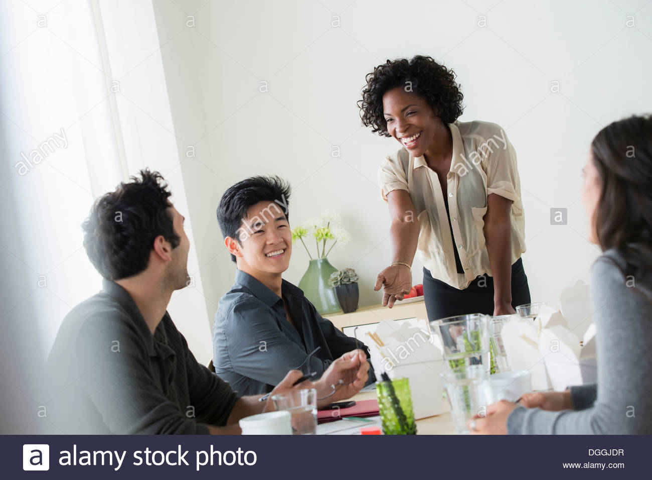 Office workers at informal meeting - Stock Image