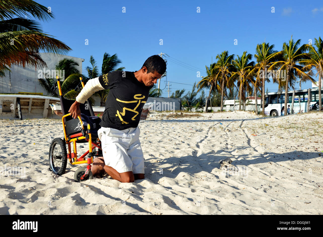 Lobster fisherman suffering from the bends after a diving accident leaving his wheelchair to do physiotherapy exercises to fight - Stock Image