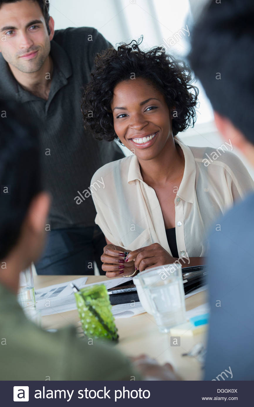 Informal portrait of female office worker with colleagues - Stock Image
