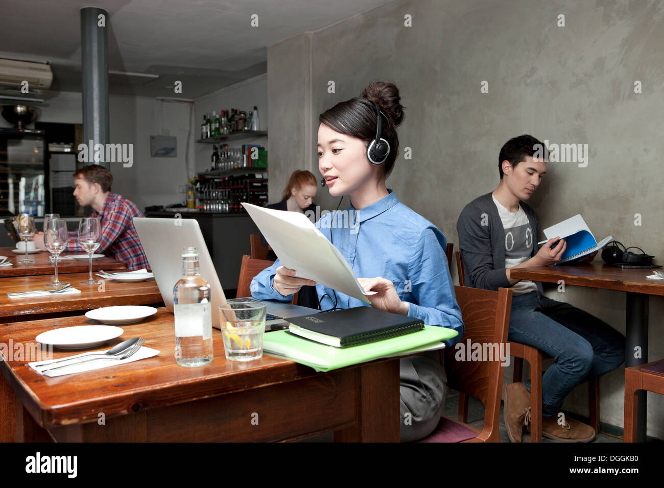 Young woman with laptop in cafe Stock Photo