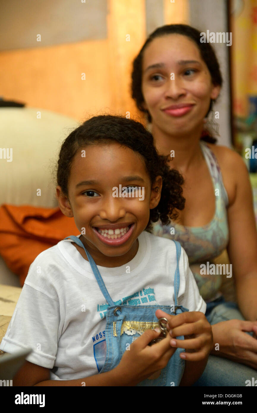 Girl and mother in a slum or favela, Jacarezinho favela, Rio de Janeiro, Rio de Janeiro State, Brazil - Stock Image