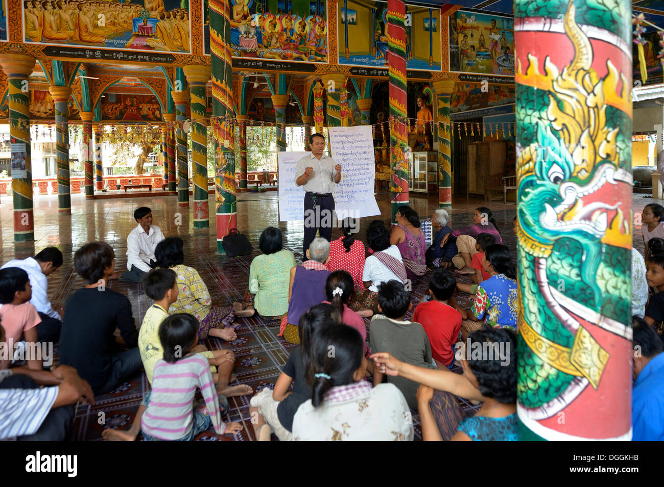 Meeting with village residents organized by a charity in the local pagoda to get together to discuss problems and - Stock Image
