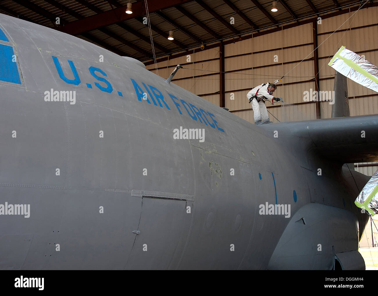 Mr. Larry Allen, Aircraft Painter, L3 Communications Integrated Systems Vertex Aerospace, apply paint to protect the C130 aircraft body from corrosion that can easily occur at high altitudes at Sheppard Air Force Base, Texas, Oct. 09. Aircraft painter's r - Stock Image
