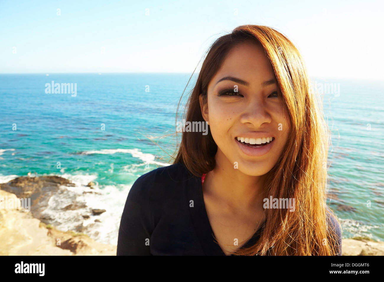 Portrait of young woman smiling, Palos Verdes, California, USA - Stock Image