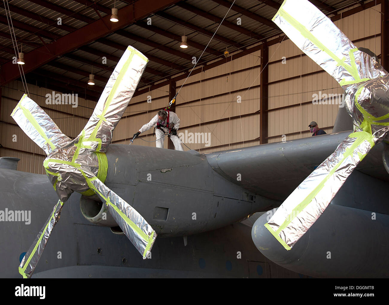 Mr. Larry Allen, Aircraft Painter, L3 Communications Integrated Systems Vertex Aerospace, apply paint to protect Stock Photo