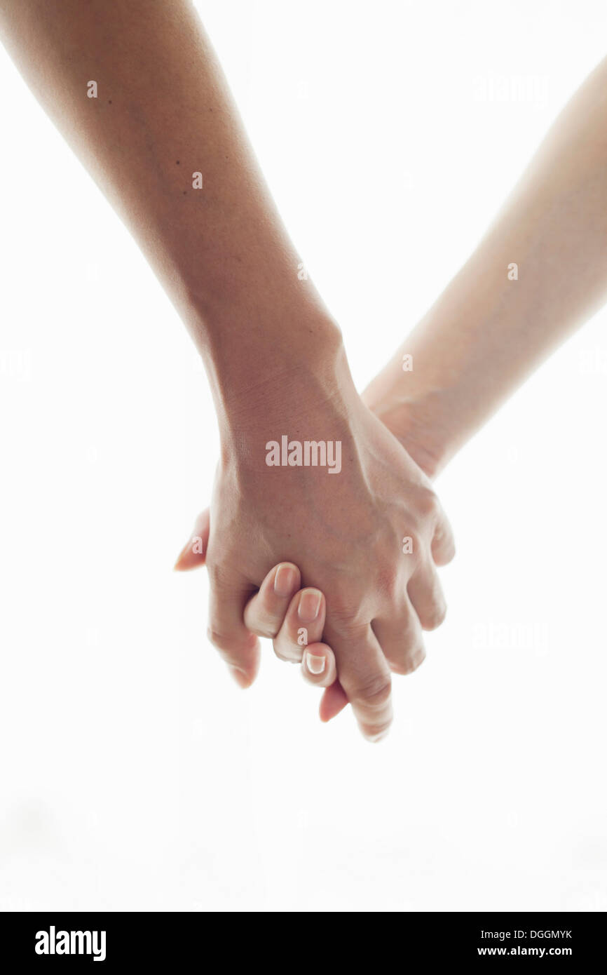Man and woman holding hands, portrait - Stock Image
