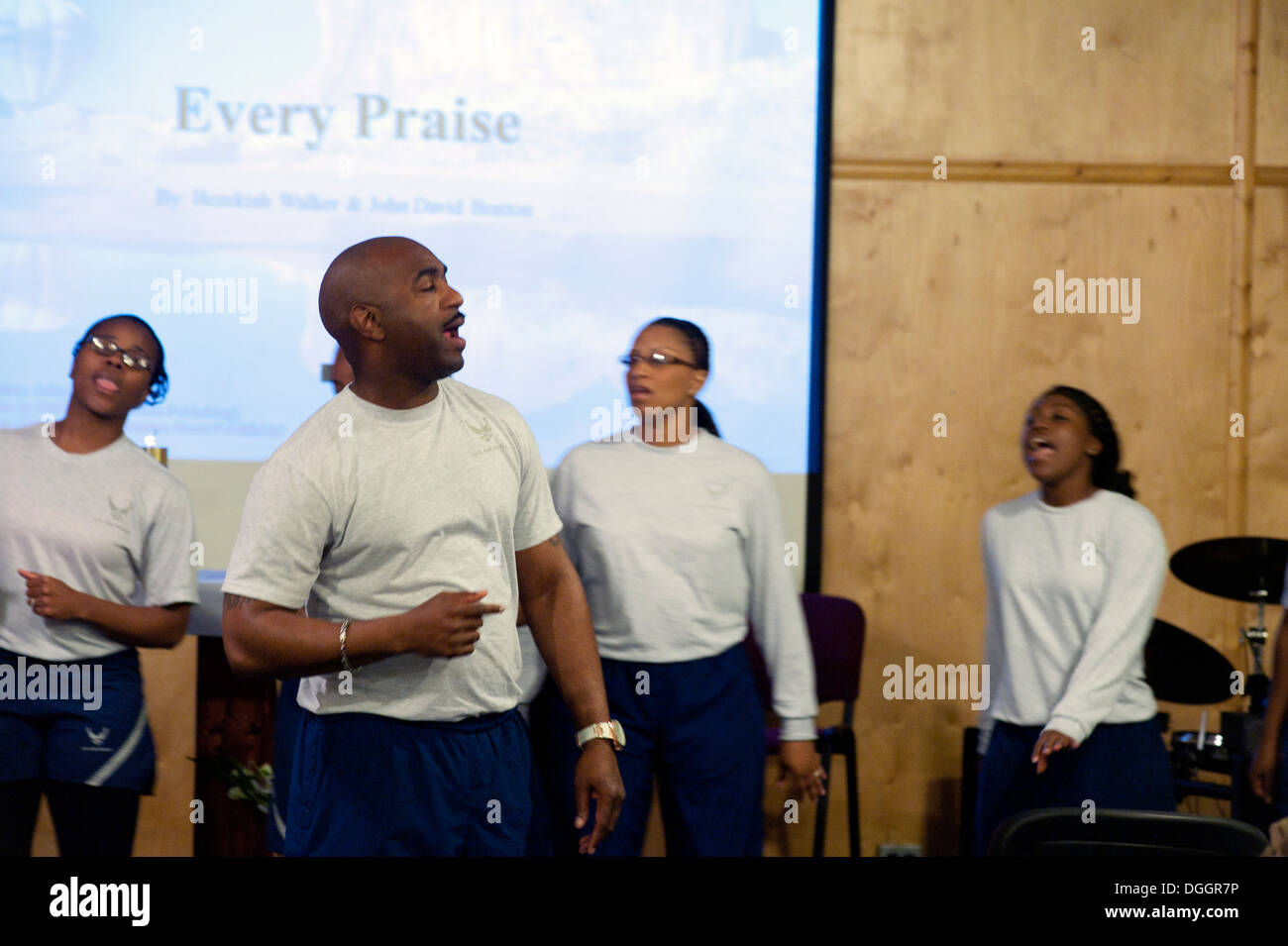 Members of the Gospel service choir perform during the 376th Air Expeditionary Wing Chapel music extravaganza at Transit Center - Stock Image