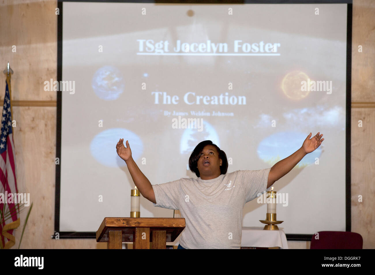 Tech. Sgt. Jocelyn Foster tells a poetic story of 'The Creation' based on the creation account in the book of Genesis during a music extravaganza at the 376th Air Expeditionary Wing Chapel at Transit Center at Manas, Kyrgyzstan, Oct. 6, 2013. Foster is a - Stock Image