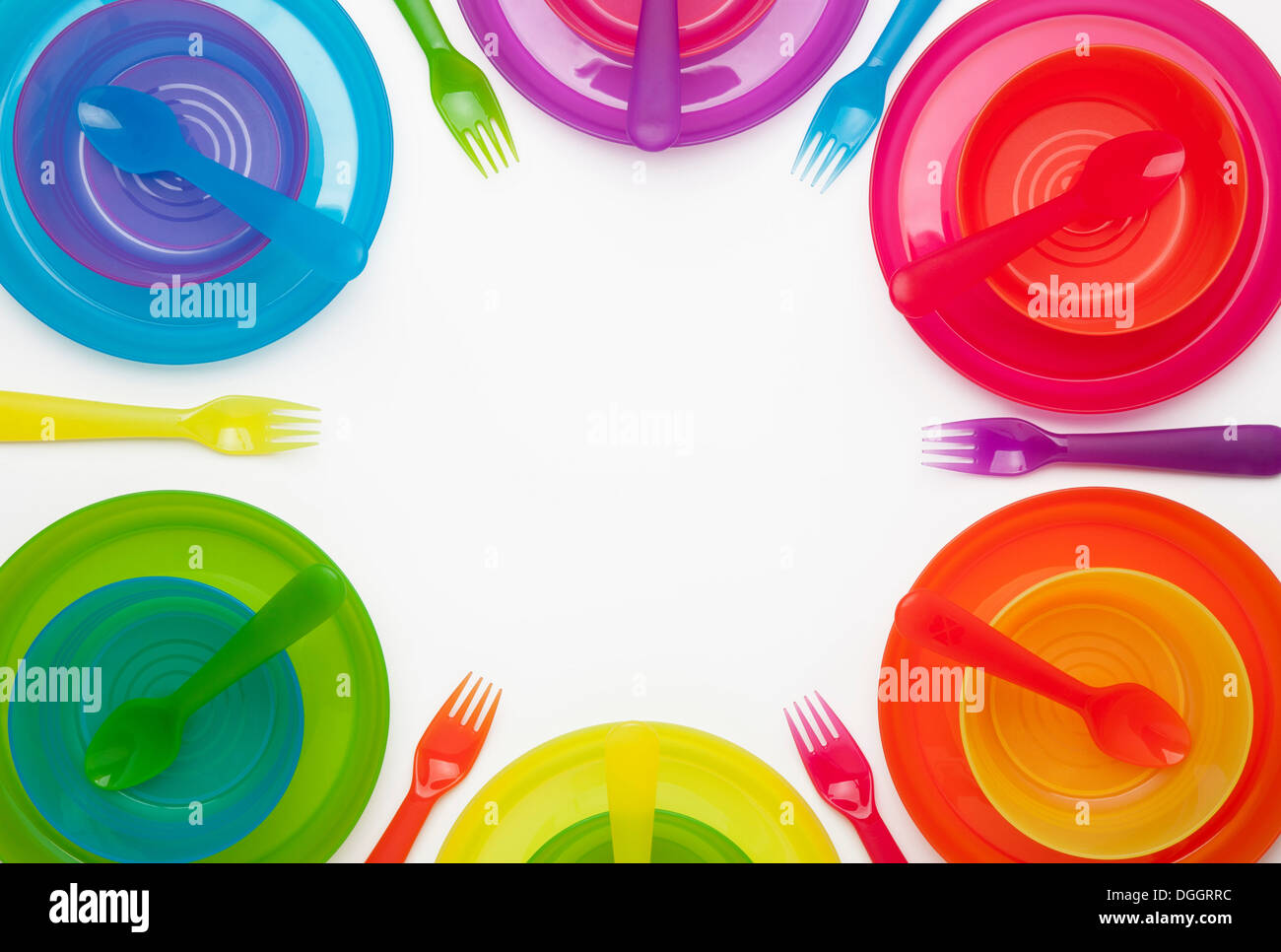 Colourful plastic plates cups bowls spoons and forks  sc 1 st  Alamy & Colourful plastic plates cups bowls spoons and forks Stock Photo ...